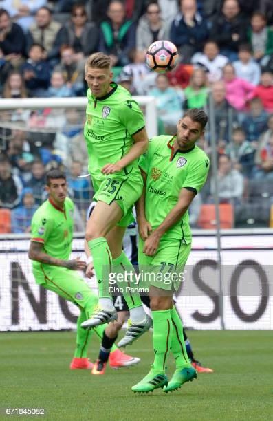 Bartosz Salamon and Bartosz Salamon of Cagliari Calcio in action during the Serie A match between Udinese Calcio and Cagliari Calcio at Stadio Friuli...