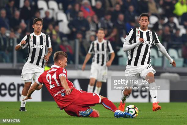Bartosz Salamon of Spal and Rodrigo Bentancur of Juventus fight for the ball during the Serie A match between Juventus and Spal on October 25 2017 in...