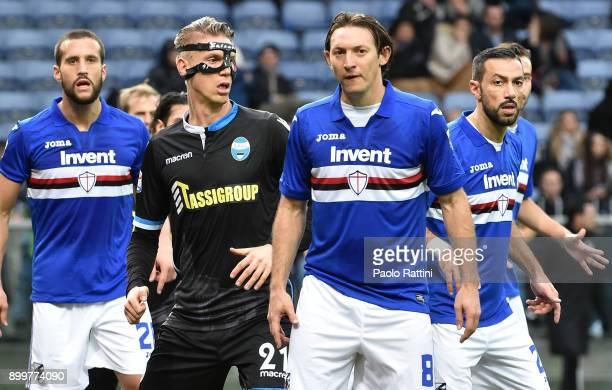 Bartosz Salamon of Spal wears a mask with Matias Silvestre Edgar Barreto and Fabio Quagliarella of Sampdoria during the serie A match between UC...