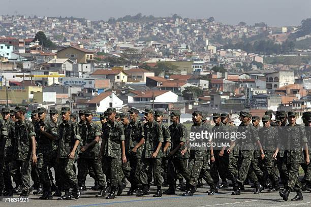 Brazilian Army troops of 20th Light Artillery Group walk back to their compound after taking part in a ceremony with Brazilian President Luiz Inacio...