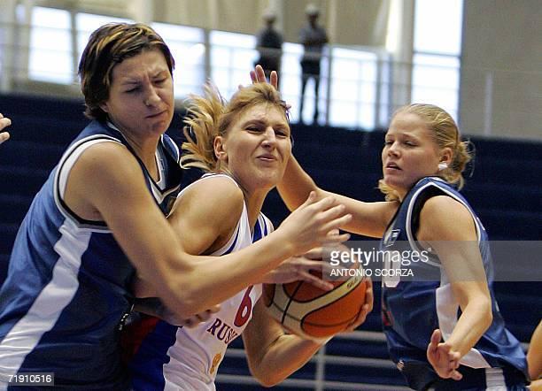 Czech Republic Petra Kulichova and Marketa Mokrosova block Russia's Natalia Vodopyanova, during their FIBA World Championship for Women Brazil 2006...