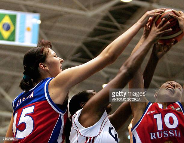 Ekaterina Lisina and Ilona Korstin of Russia vies for the ball with Taimara Coronado Suero of Cuba 18 September 2006 during their FIBA World...