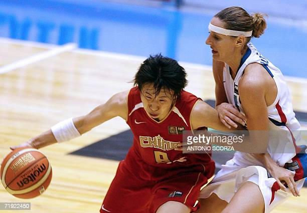 Lijie Miao of China fights for the ball with Audrey Sauret Gillespie of France 18 September 2006, during their FIBA World Championship for Women...