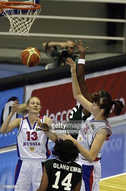 Russia's basketball female team players Elena Karpova and Ekaterina Lisina fight for the ball with Morolake Ogunoye and Adeola Olanrewaju of Nigeria...