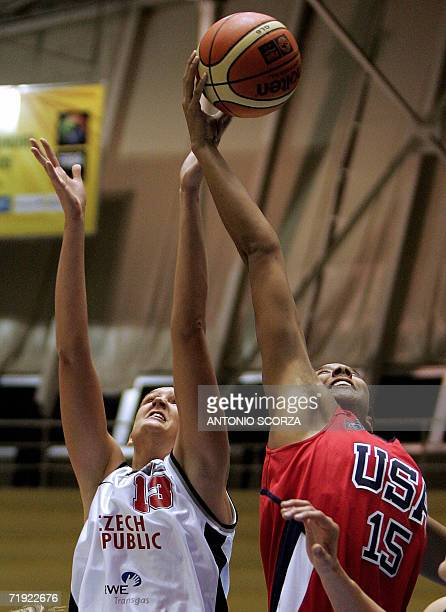 Candace Parker fights for the ball with Czech Republic's Petra Kulishova 18 September during their FIBA World Championship for Women Brazil 2006...