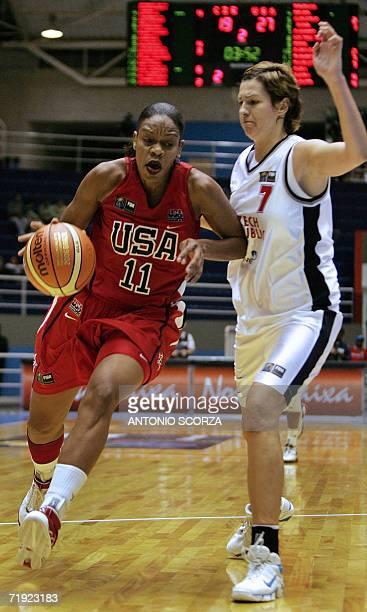 Tina Thompson carries the ball as Czech Republic's Michala Hartigova tries to block her 18 September during their FIBA World Championship for Women...