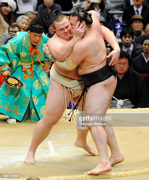 Baruto pushes out Kotooshu during day five of the Grand Sumo Spring Tournament at Osaka Prefectural Gymnasium on March 14 2013 in Osaka Japan