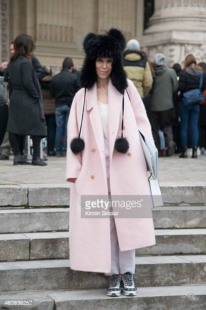 Barvikhadreamcom boutique owner Anna Dolgova poses wearing a Rochas coat and Chanel shoes and bag day 3 of Paris Haute Couture Fashion Week...