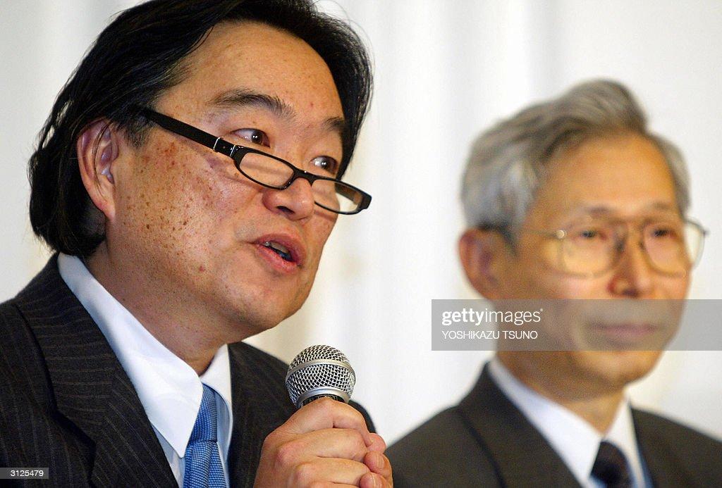 Baryn Sumio Futa (L), CEO of MPEG LA ann : News Photo