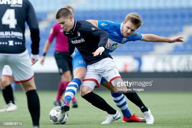 Bas Aalderink of FC Emmen U19 Lars Miedema of PEC Zwolle U19 during the match between PEC Zwolle U19 v FC Emmen U19 at the MAC3PARK Stadion on...