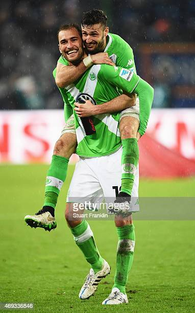 HAMBURG GERMANY APRIL Bas Dost and Daniel Caligiuri of Wolfsburg celebrate after the Bundesliga match between Hamburger SV and VfL Wolfsburg at...