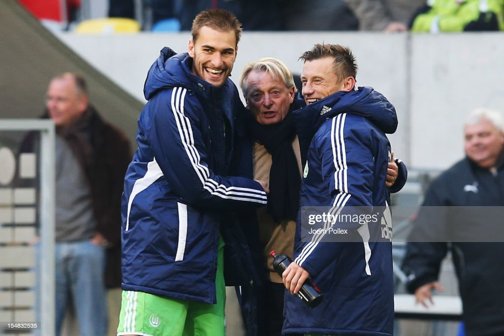 Bas Dost (L) and Ivica Olic (R) and interim head coach Lorenz-Guenther Koester of Wolfsburg celebrate after winning the Bundesliga match between Fortuna Duesseldorf 1895 and VfL Wolfsburg at Esprit-Arena on October 27, 2012 in Duesseldorf, Germany.