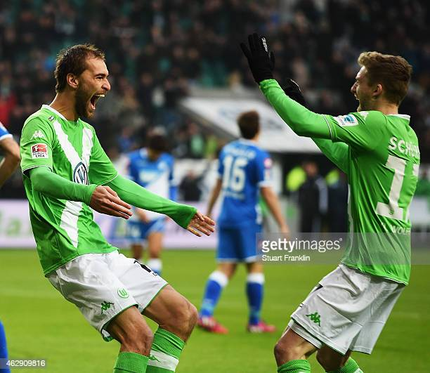 Bas Dost celebrates scoring his goal with Andre Schuerrle of Wolfsburg during the Bundesliga match between VfL Wolfsburg and 1899 Hoffenheim at...