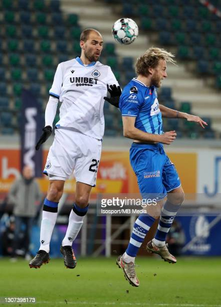 Bas Dost of Club Brugge battles for the ball with Roman Bezus of KAA Gent during the Jupiler Pro League match between KAA Gent and Club Brugge KV at...
