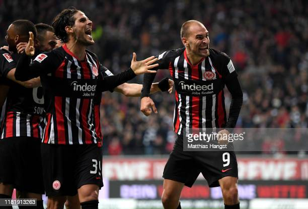 Bas Dost of Eintracht Frankfurt celebrates with Gonçalo Paciência after scoring his team's 3rd goal during the Bundesliga match between Eintracht...