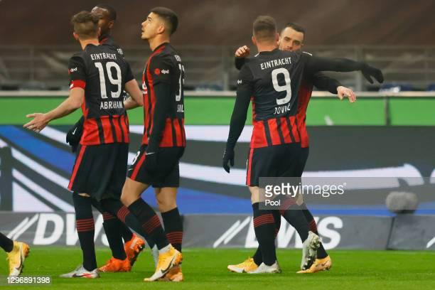 Bas Dost of Eintracht Frankfurt celebrates with team mates after scoring their side's second goal during the Bundesliga match between Eintracht...