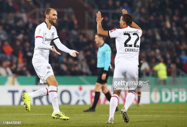 Bas Dost of of Eintracht Frankfurt celebrates after scoring his team's first goal with Timothy Chandler of Eintracht Frankfurt during the DFB Cup...
