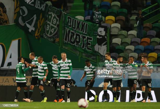 Bas Dost of Sporting CP celebrates with teammates after scoring a goal during the Liga NOS match between Sporting CP and GD Chaves at Estadio Jose...