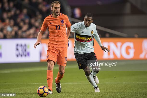 Bas Dost of The Netherlands Christian Kabasele of Belgiumduring the friendly match between Netherlands and Belgium at the Amsterdam Arena on November...