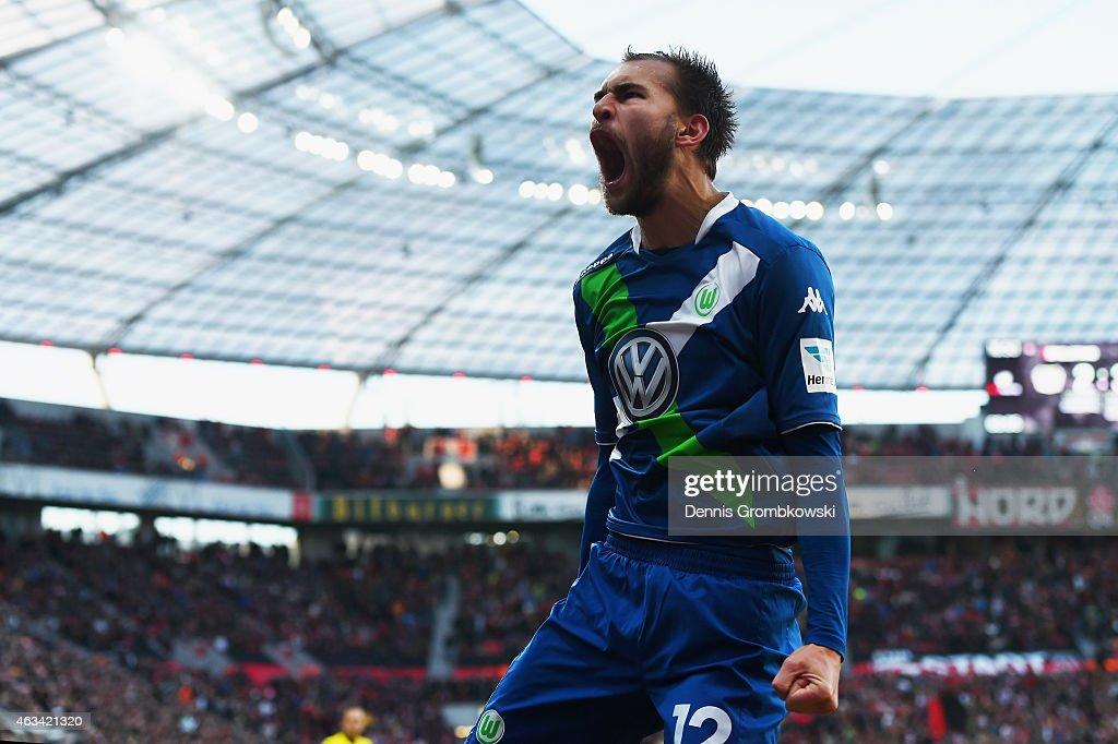 Bas Dost of VfL Wolfsburg celebrates as he scores the fourth goal during the Bundesliga match between Bayer 04 Leverkusen and VfL Wolfsburg at BayArena on February 14, 2015 in Leverkusen, Germany.