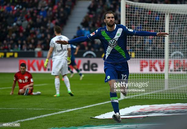 Bas Dost of VfL Wolfsburg celebrates as he scores the fourth goal during the Bundesliga match between Bayer 04 Leverkusen and VfL Wolfsburg at...