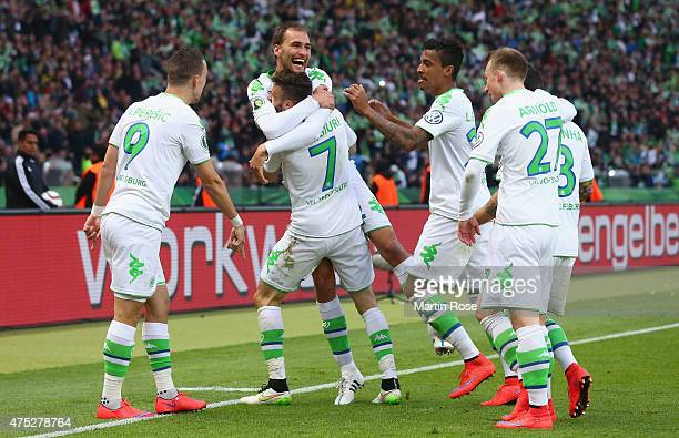 Bas Dost of VfL Wolfsburg celebrates with team mates after scoring his teams third goal during the DFB Cup Final match between Borussia Dortmund and...