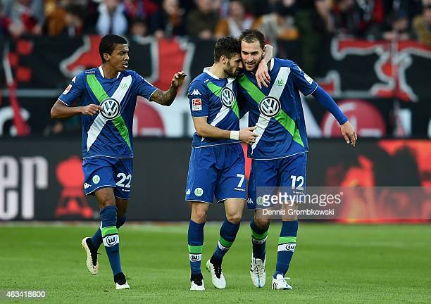 Bas Dost of VfL Wolfsburg celebrates with team mates as he scores the third goal during the Bundesliga match between Bayer 04 Leverkusen and VfL...