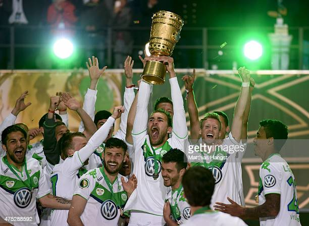 Bas Dost of VfL Wolfsburg celebrates with the trophy after his teams victory in the DFB Cup Final match between Borussia Dortmund and VfL Wolfsburg...