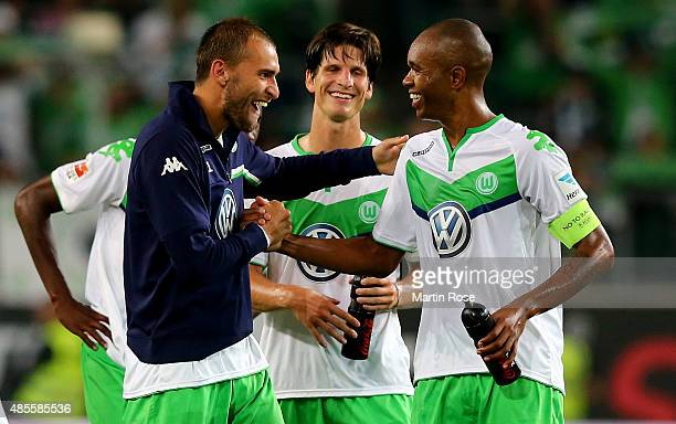 Bas Dost of VfL Wolfsburg celebrates with Timm Klose of VfL Wolfsburg and Naldo of VfL Wolfsburg after winning the Bundesliga match between VfL...