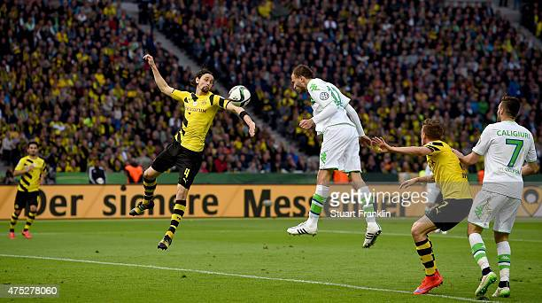 Bas Dost of VfL Wolfsburg heads his teams third goal during the DFB Cup Final match between Borussia Dortmund and VfL Wolfsburg at Olympiastadion on...