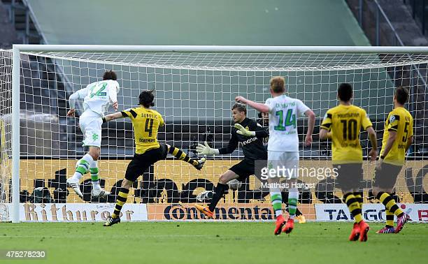 Bas Dost of VfL Wolfsburg scores his team's third goal during the DFB Cup Final match between Borussia Dortmund and VfL Wolfsburg at Olympiastadion...