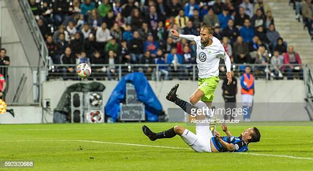 Bas Dost of VfL Wolfsburg scores the second goal for his team against Christopher Schorch of FSV Frankfurt during the DFB Cup match between FSV...