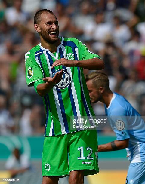 Bas Dost of Wolfsburg celebrates his team's second goal during the DFB Cup First Round match between Stuttgarter Kickers and VfL Wolfsburg at...