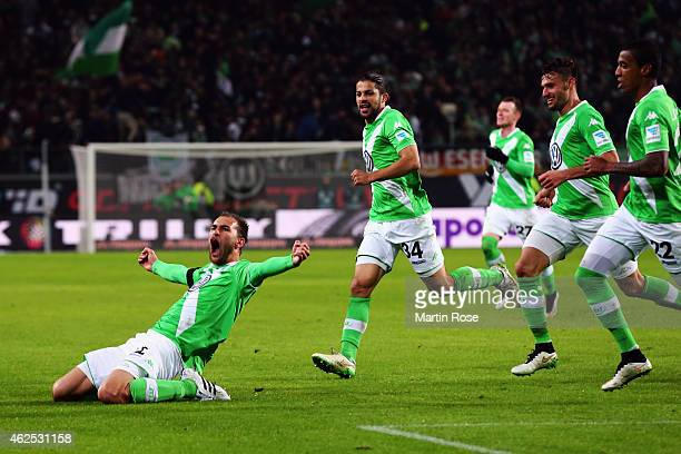 Bas Dost of Wolfsburg celebrates his team's second goal with team mates during the Bundesliga match between VfL Wolfsburg and FC Bayern Muenchen at...