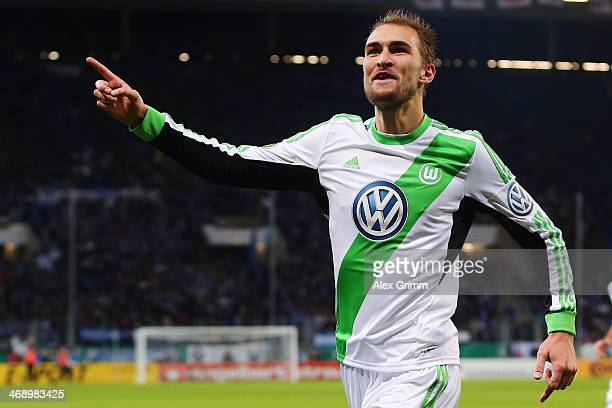 Bas Dost of Wolfsburg celebrates his team's third goal during the DFB Cup quarterfinal match between 1899 Hoffenheim and VfL Wolfsburg at Wirsol...