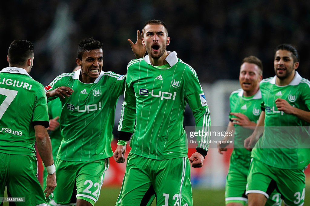 Bas Dost (#12) of Wolfsburg celebrates scoring his teams second goal of the game during the Bundesliga match between Borussia Moenchengladbach and VfL Wolfsburg held at Borussia-Park on December 22, 2013 in Moenchengladbach, Germany.