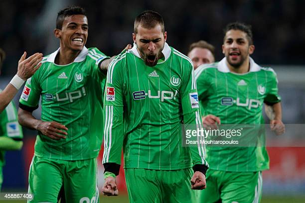 Bas Dost of Wolfsburg celebrates scoring his teams second goal of the game during the Bundesliga match between Borussia Moenchengladbach and VfL...