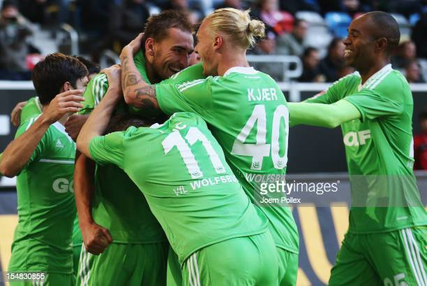 Bas Dost of Wolfsburg celebrates with his team mates after scoring his team's third goal during the Bundesliga match between Fortuna Duesseldorf 1895...