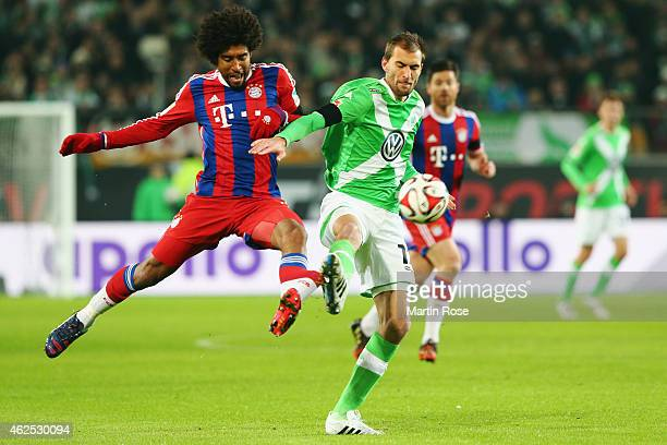 Bas Dost of Wolfsburg is challenged by Dante of Muenchen during the Bundesliga match between VfL Wolfsburg and FC Bayern Muenchen at Volkswagen Arena...