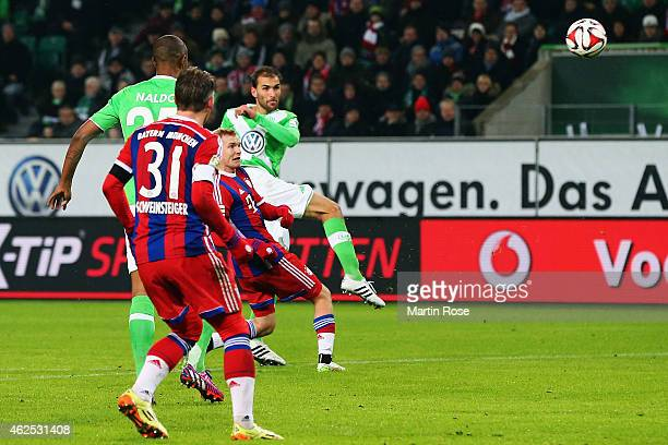 Bas Dost of Wolfsburg scores his team's second goal during the Bundesliga match between VfL Wolfsburg and FC Bayern Muenchen at Volkswagen Arena on...