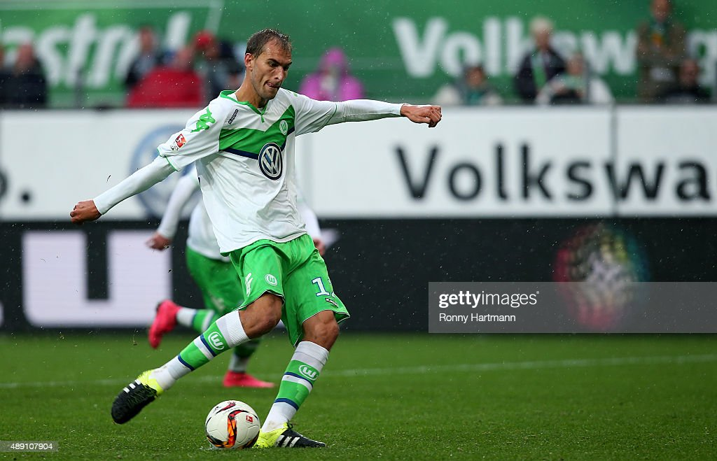 Bas Dost of Wolfsburg scores his team's second goal from the penalty spot during the Bundesliga match between VfL Wolfsburg and Hertha BSC at Volkswagen Arena on September 19, 2015 in Wolfsburg, Germany.