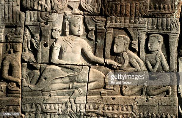 Bas relief at the Bayon temple in Angkor. This scene depicts an audience with a dignitary or the king..