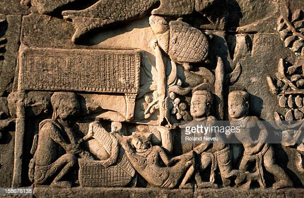 Bas relief at the Bayon temple in Angkor. This scene depicts the birth of a baby..