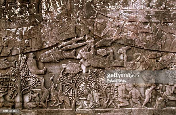 Bas relief at the Bayon temple in Angkor Wat This scene depicts a scene where prisoners are fed to crocodiles