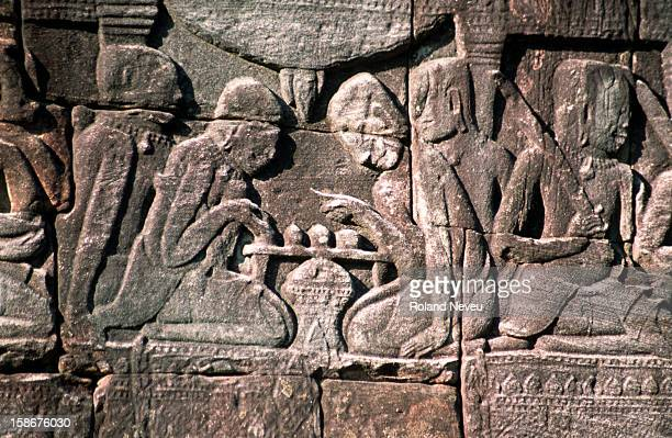 Bas relief at the Bayon temple in Angkor Wat. This scene depicts a game..