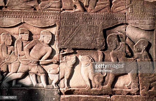 Bas relief at the Bayon temple in Angkor Wat. This scene depicts two fighting dogs..