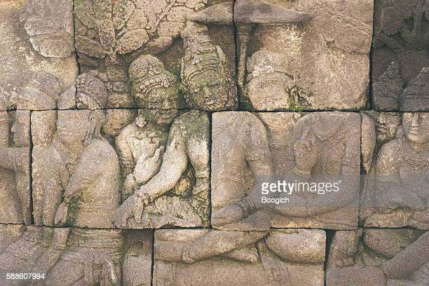 Bas Relief Carvings in Ancient Indonesian Borobudur UNESCO Buddhist Temple
