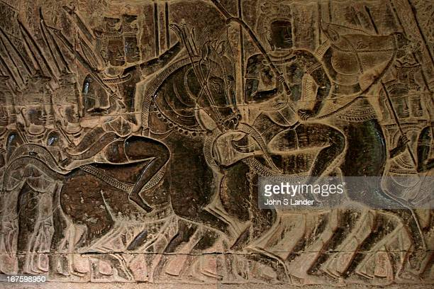 Bas relief gallery at Angkor Wat Angkor Wat was built for King Suryavarman II in the early 12th century as his state temple and capital city As the...