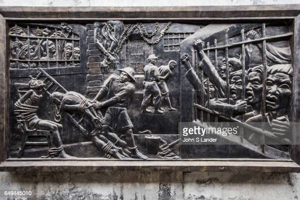 Bas Relief Mural at Hoa Loa Hanoi Hilton Prison Hoa Loa Prison was originally used by the French colonial system to detain what they considered to be...