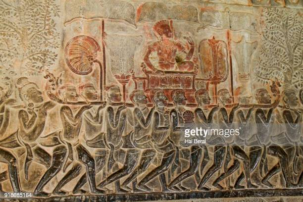 bas relief of royal person being carried on litter at angkor wat - palanquin stock photos and pictures